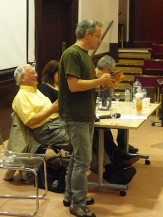 Conrad Williams reading, Ramsey Campbell, Marie O'Regan and Paul Kane in the background