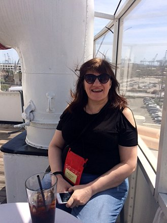 Marie O'Regan relaxing outside on the observation deck of The Queen Mary at StokerCon 2017